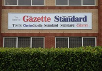 Raised Logos and Vinyl Fascia Sign in Anodised Aluminium Framing