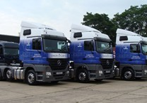 Printed Wraps Applied to 3 of Coscon's Mercedes Actros'