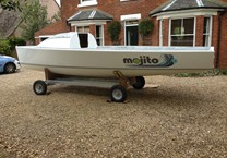 Gloss White Vinyl Wrap to Boat with Cut Vinyl Name